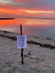 Beach closed against sunrise
