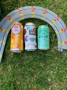 Cans of Wild Barrel Vice CranZu and One Drop Tropical Smoothie Sour and Colonial Brewing Co Sour